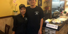 Owner Zhong Lin, left, with his wife at Lucky Pot restaurant in Courthouse