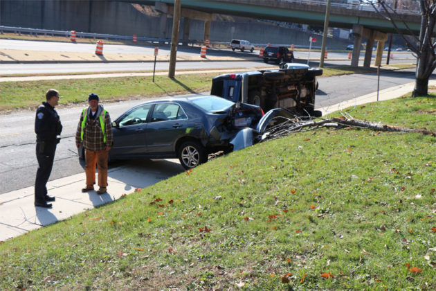 A van collided with a parked sedan, sending both over an embankment in Ft. Myer Heights