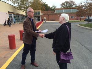 John Vihstadt greeting a voter outside the Walter Reed Recreation Center 11/4/14