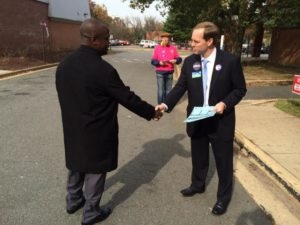 Alan Howze talks to a voter outside the Wilson School in Rosslyn 11/4/14