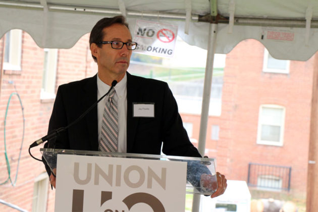 County Board Chair Jay Fisette speaks to the crowd at the groundbreaking for the Union at Queen apartments