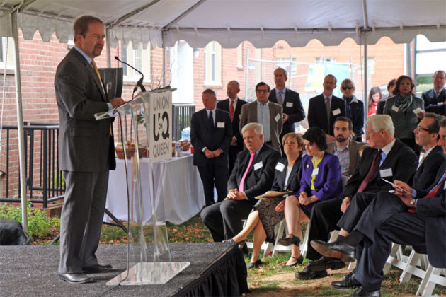 Edmund Delaney of Capital One Bank speaks to the crowd at the groundbreaking for the Union at Queen apartments