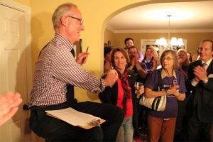 John Vihstadt high-fives fellow County Board member Libby Garvey at his election party Nov. 4, 2014