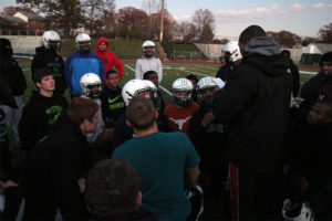 Wakefield football huddles around head coach Wayne Hogwood