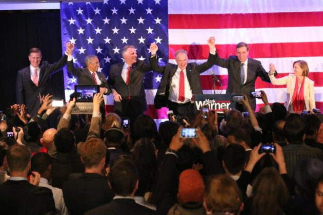 Gov. Terry McAuliffe, Sen. Tim Kaine, Sen. Mark Warner and Don Beyer in Crystal City in Nov. 2014