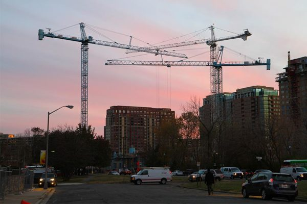 Construction cranes at sunset in Pentagon City