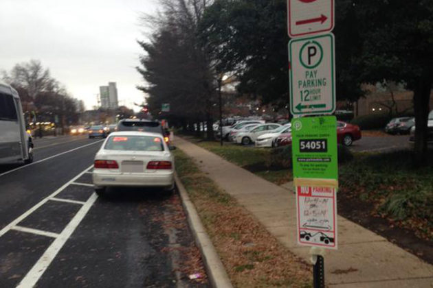 Cars parked illegally in new S. Eads Street bike lane (photo via @MMagette)