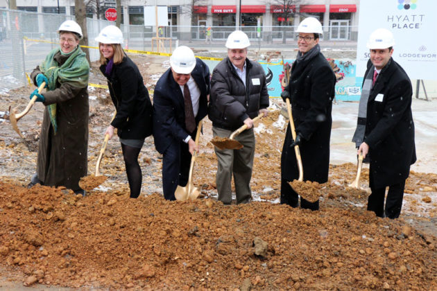Officials turn dirt at the Hyatt Place groundbreaking in Courthouse