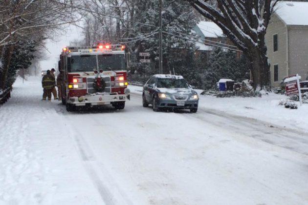 A fire crew helps stuck motorists on 23rd Street S.