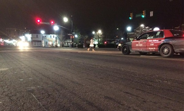 Brine pre-treatment on Columbia Pike Sunday night, as raindrops start falling