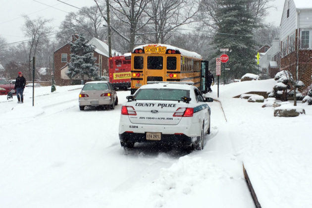 Car hits a stuck school bus at S. Joyce and 23rd Street. No children were on board.