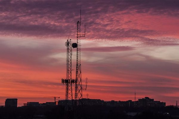 Radio antennas in South Arlington at sunset