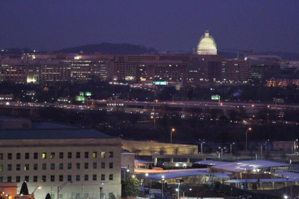 Capitol dome at night with the Pentagon in the foreground
