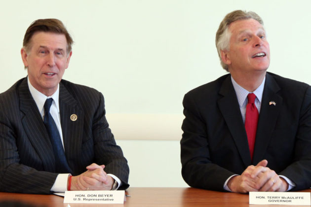 Rep. Don Beyer, left, and Gov. Terry McAuliffe discuss the Affordable Care Act Monday morning