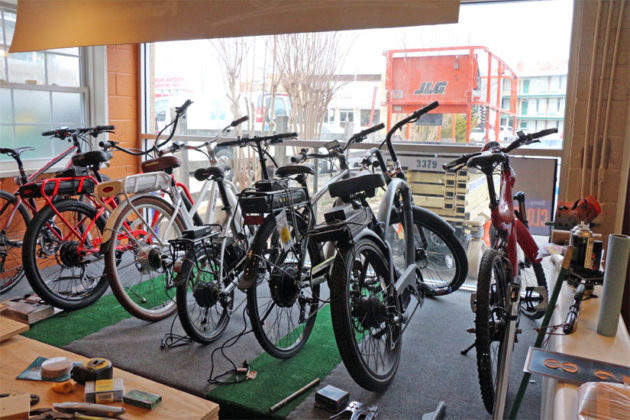 E-bicycles at the under-renovation Hybrid Bikes shop in Virginia Square