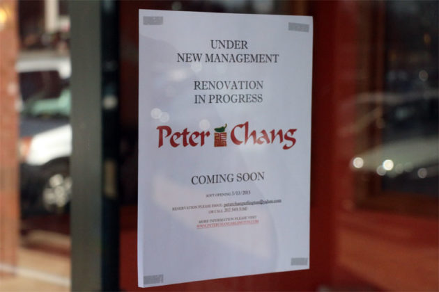 A sign announcing the opening of Peter Chang Arlington, on the storefront's door