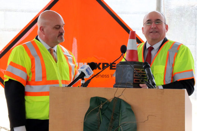 Federal Highway Administration Deputy Administrator Gregory Nadeau gives an award to VDOT Commissioner Charles Kilpatrick