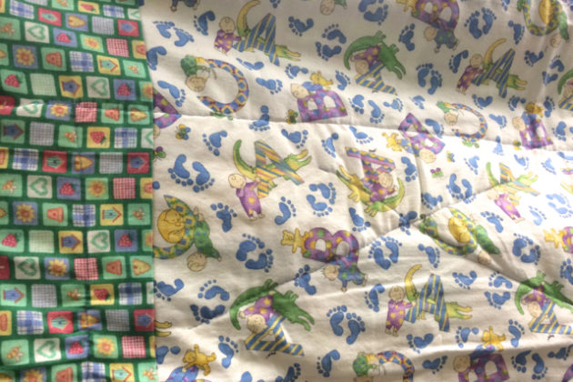 Closeup of quilt made by female inmate