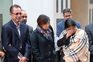 Chowdhury Saqlain's father, left, and his mother, right, after his killer's sentencing hearing