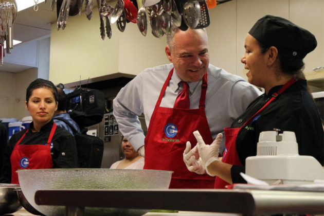 Sen. Tim Kaine speaks to La Cocina VA trainees in Arlington in April 2015