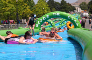A photo of a Slide the City event (photo via Slide the City)