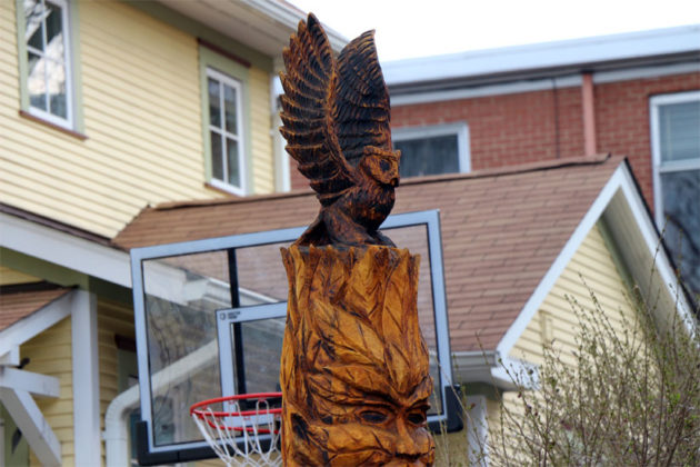 An owl tree carving in Maywood, on 21st Avenue N.