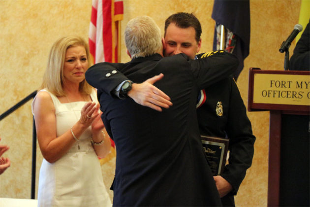 ACFD Chief Jim Schwartz embraces Firefighter/EMT Chad Aldridge after presenting the Valor Award