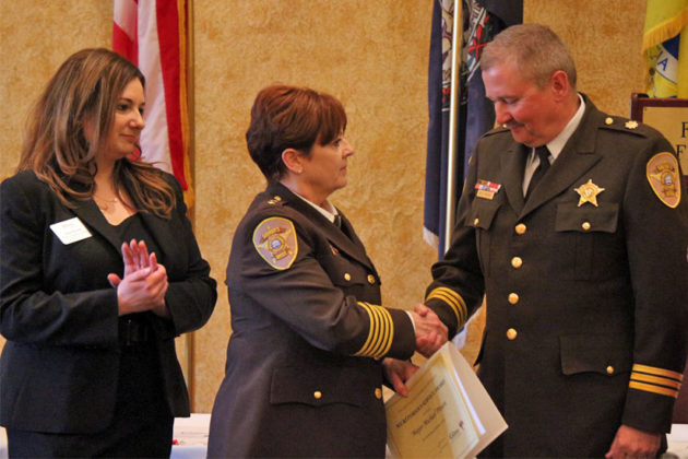 Sheriff Beth Arthur gives Maj. Michael Pinson the Meritorious Service Award