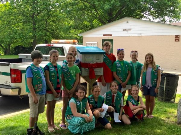 Girl Scout Troop 3661 in front of their Little Free Library in Bluemont Park, Photo courtesy of Girl Scout Troop 3661, photo courtesy of Photo courtesy of Girl Scout Troop 3661.
