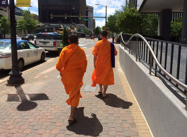 Two men in religious garb walking through Rosslyn