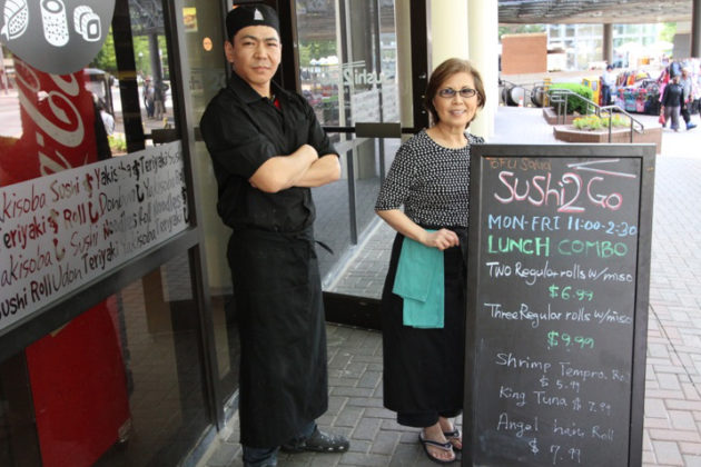 Sushi 2Go owner Unsook Kim poses with chef  Zagiraa Nyamaa in front of the eatery.