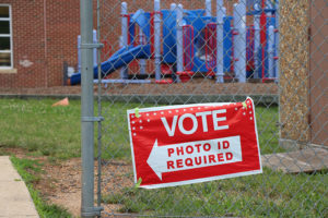 """Photo ID required"" voting sign"