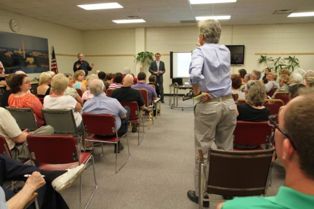 An Arlington Ridge resident argues during the RiverHouse development meeting
