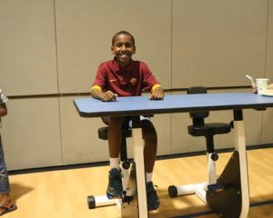 Oakridge student on a pedal desk