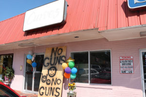 """No Guns"" sign outside of former Curves studio."