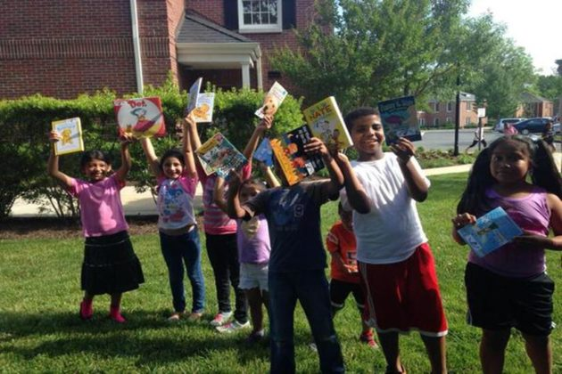 Neighborhood kids proudly show off their literary finds (courtesy photo)