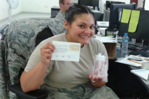Female service member with spa goods