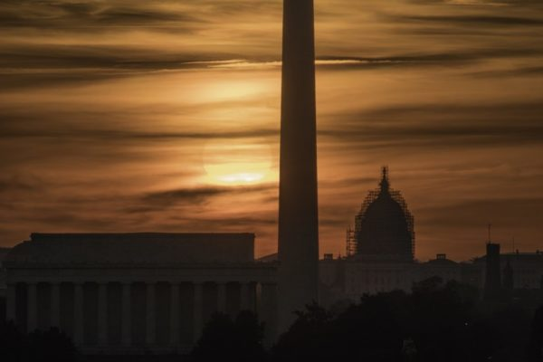 D.C. sunrise, as seen from Arlington (Flickr pool photo by Kevin Wolf)