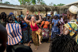 Sarah Lee Parker Mansare, leader of the Guinea trip, dances in the heart of inland Guinea (Courtesy of Megan Morrison)