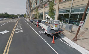 Commercial vehicle parked in the bike lane on Quincy Street (image via Google Maps)