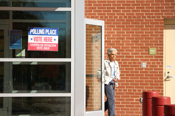 A woman walks out of the Walter Reed Recreation Center after voting (file photo)