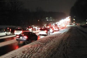 Very heavy traffic during a snowy evening commute on Jan. 20, 2016