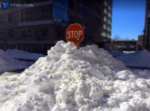 Snow piled in front of a stop sign during the January 2016 blizzard (photo via Arlington County)