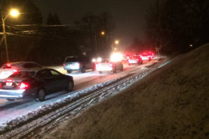 Traffic in Arlington during a light surprise snowfall on Jan. 20, 2016
