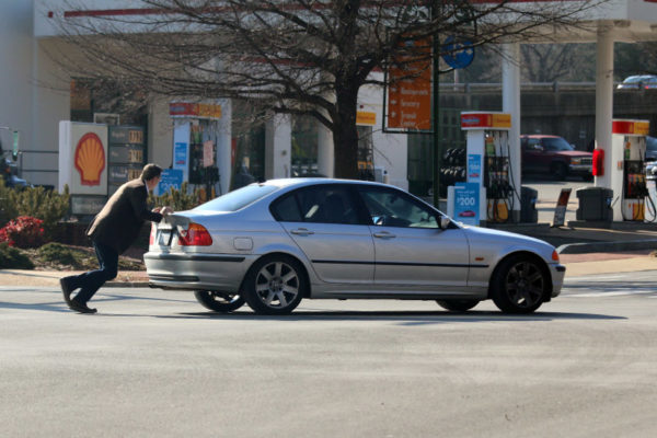 Man pushing a disabled BMW to the Shell station in Shirlington 3/7/16