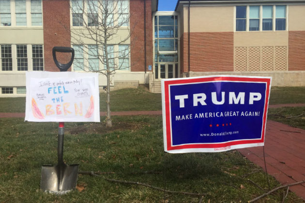 Donald Trump and Bernie Sanders signs outside the Arlington Arts Center