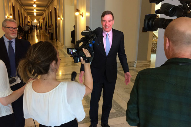 Sen. Mark Warner holds a press conference outside of his office on Capitol Hill
