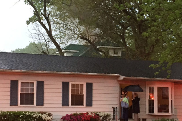 Smoke rising from the roof of a house in the background (Photo courtesy Steve Thurston)