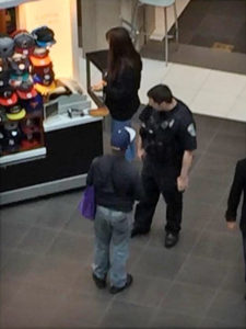 ACPD officer buying a man a hat at Pentagon City mall