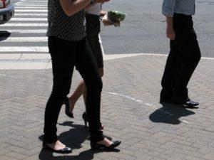 Young people walking on a sidewalk in Ballston